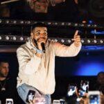 Drake difende una sua fan interrompendo il concerto (VIDEO)